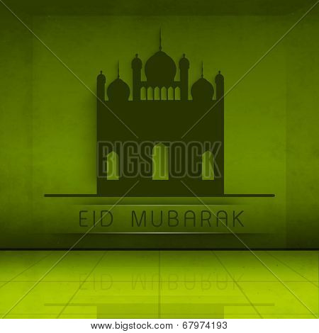 Beautiful green paper mosque for Muslim community festival Eid Mubarak celebrations.