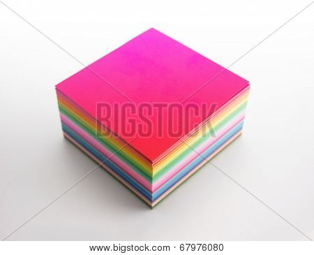 Colorful gradated origami paper stacked, isolated on white,