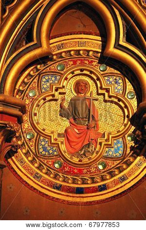 PARIS, FRANCE - NOV 06, 2012: Icon on the wall of lower level of royal palatine chapel, Interiors detail of the Sainte Chapelle, built in 1239, in Ile de la Cite, Nov 06, 2012 in Paris, France.