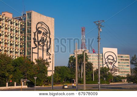 HAVANA, CUBA - FEB 6, 2011: Popular government building with Che Guevara and Camilo Cienfuegos image in front of Revolution square.
