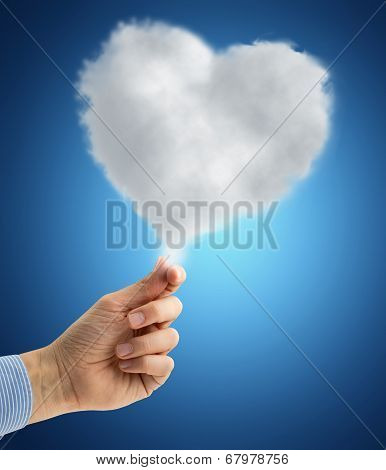 hand holding a heart-shaped cloud