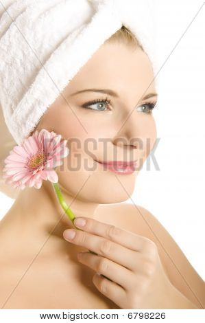 Close-up Portrait Of Young Beautiful Woman With Healthy Pure Skin Holding Pink flower