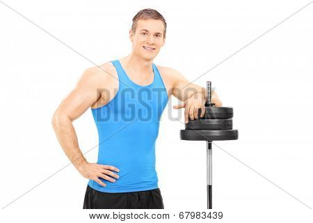Muscular man leaning on a barbell isolated on white background