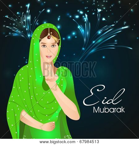 Beautiful muslim young woman saying salam in fireworks night for the celebrations of Muslim community festival Eid Mubarak.
