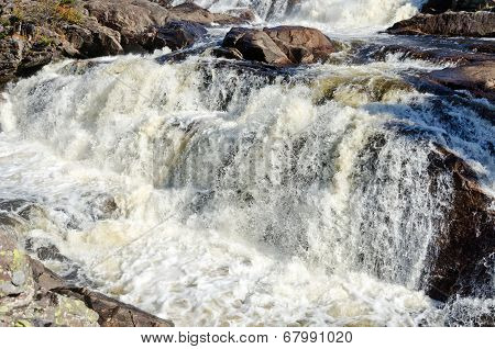 Cascading Water Over Rocks