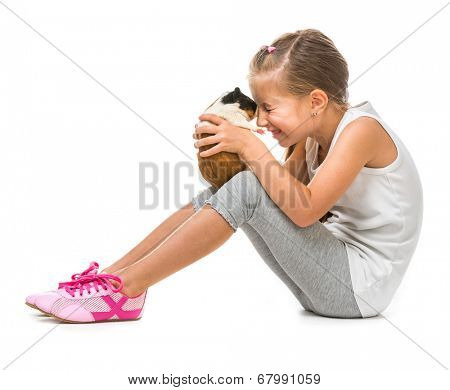 happy cute girl with a cavy. studio shot isolated on white