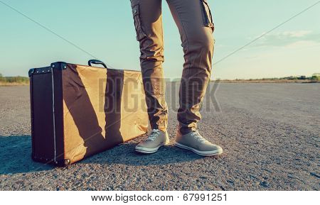 Traveler Stands Near The Suitcase poster