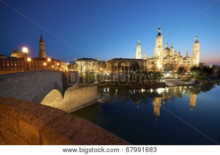 View of the  basilica of the Virgen del Pilar and Ebro river, on the left is located the medieval bridge called Puente de Piedra, Zaragoza, Aragon, Spain