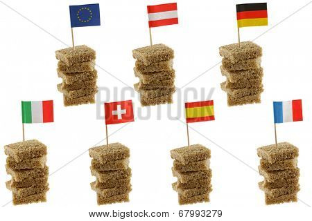 Different European flag toothpicks on Wholemeal, wholewheat brown bread (1st row : Flag of European Union, Austria, Germany) (2nd row : Flag of Italy, Switzerland, Spain, France)
