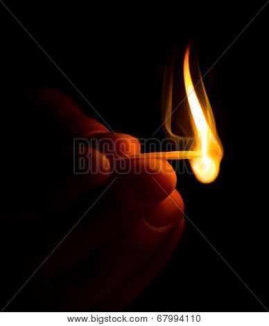 Hand with burning match
