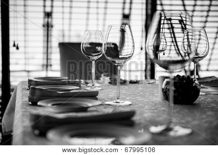 Served Table With Glasses. Black And White Image