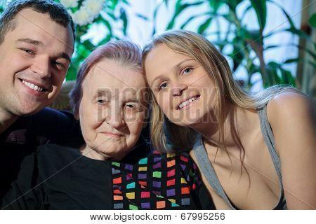 Happy couple posing with grandma