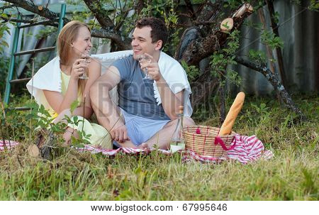 Young couple on picnic in the countryside