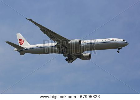 Air China Boeing 777 in New York sky before landing at JFK Airport