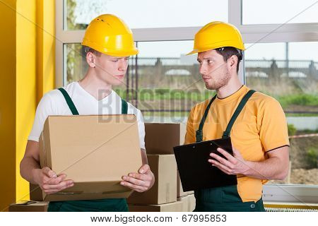 Storekeepers During Work At Warehouse