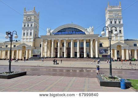 KHARKOV, UKRAINE - JUNE 5, 2014: People in front of the building of the main railway station. The building opened in 1952 in place of the previous building destructed during the World War II