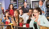 stock photo of disrespect  - Group of people annoyed with obnoxious person on phone - JPG