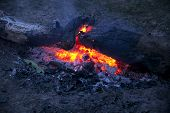 foto of ember  - Red embers of bonfire in the evening - JPG
