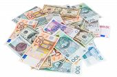 image of zloty  - Heap of dollar euro and polish zloty banknotes isolated on white background with clipping path - JPG