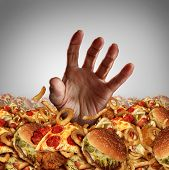 pic of obese  - Obesity and overweight concept as the hand of a person emerging from a heap of unhealthy fast food and desperately reaching out for diet and dieting help as a symbol of bad nutrition proplems - JPG