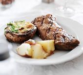 image of braai  - grilled strip steak with potatoes and stuffed mushroom - JPG