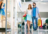 foto of mall  - Portrait of young couple shopping in the mall - JPG