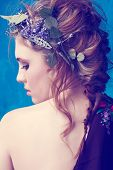 picture of bohemian  - portrait of a beautiful woman with red hair in curly braided hairstyle wearing a crown of fresh flowers - JPG