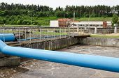 stock photo of aeration  - wastewater sewage water aeration basin bubbling and big pipes blowing oxygen - JPG