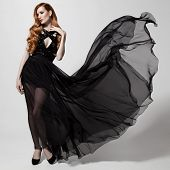 image of flutter  - Fashion woman in fluttering black dress - JPG