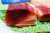 image of yellowfin tuna  - photography close up of raw fish from marketplace