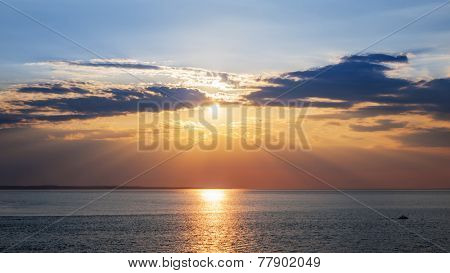 Sunset and sunrays with dramatic sky over Atlantic Ocean in Prince Edward Island, Canada
