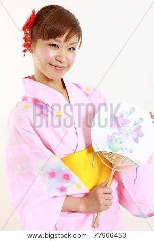 Young woman with paper Fan