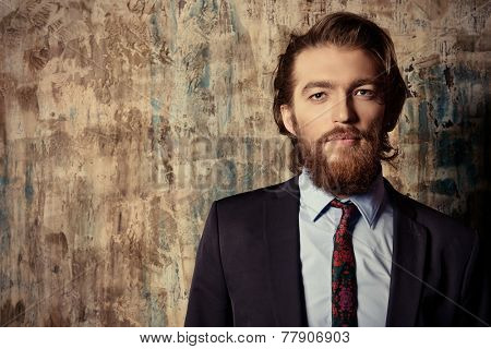 Respectable handsome man in a suit smiles at camera. Men's fashion.