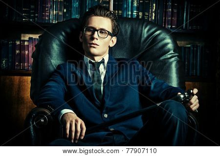 Respectable handsome man in his office. Classic vintage style.