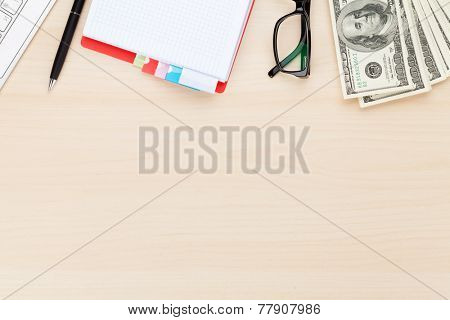 Office table with pc, supplies and money cash. View from above with copy space