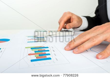 Businessman Analysing A Bar Graph