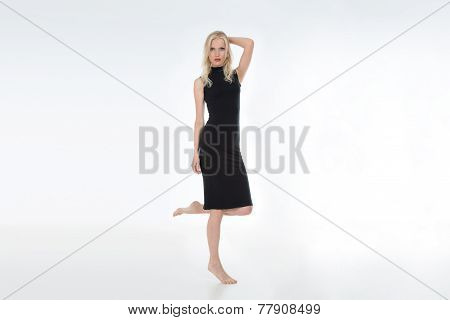 Blonde Model in Black Dress On White Background