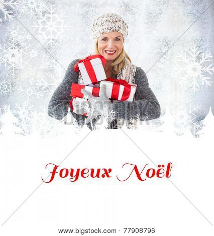 happy blonde with gifts against joyeux noel