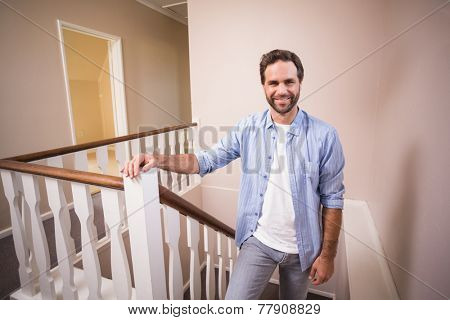 Casual man walking up the stairs in his new home