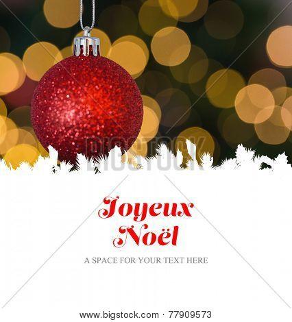 Joyeux noel against red christmas ball decoration hanging