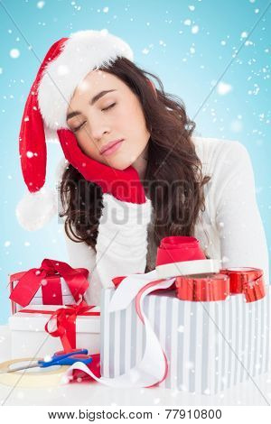 Brown hair in santa hat napping against blue background with vignette