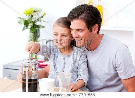 Happy Father And His Daughter Having Breakfast Together