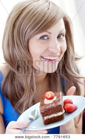 Cheerful Woman Holding A Piece Of Chocolate Cake