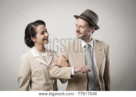 Elegant Couple Arm In Arm