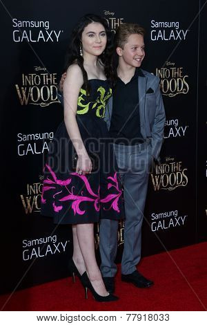NEW YORK-DEC 8: Actress Lilla Crawford (L) and Daniel Huttlestone attend the