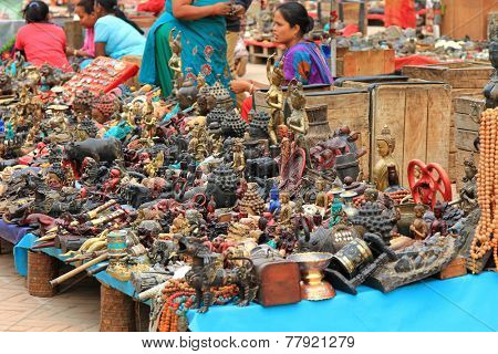 KATHMANDU, NEPAL - APRIL 12 : Many trinket and souvenir stalls at Hanuman Dhoka in the Durbar Square, Central Kathmandu, Nepal on 12 April 2014.