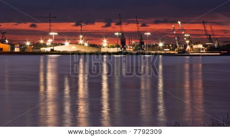 Container Port With Cranes At The Riverside
