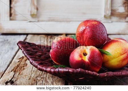 Nectarine In A Wicker Plate
