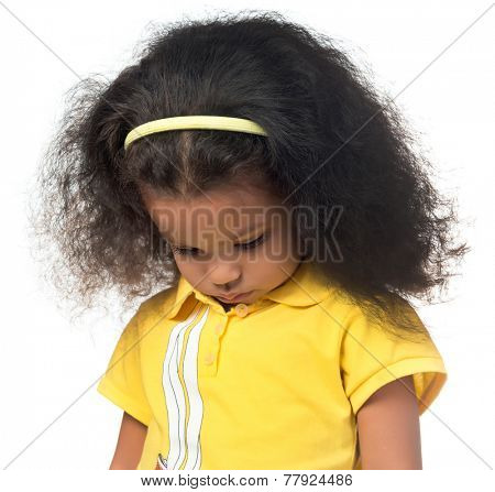 Sad or shy african american small girl looking down isolated on white