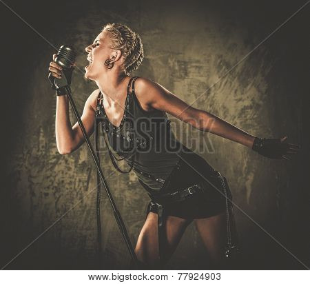 Attractive steampunk singer with microphone